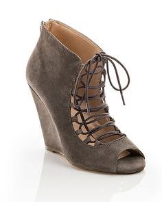 The Jordane - We dare you to try this seen-on-the-runway favorite. A playful lace-up front and sexy peep-toe add signature style to this uniquely modern wedge.