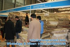 Yilong at exhibition in 2013 -- Measuring the size with customers from Exhibition.