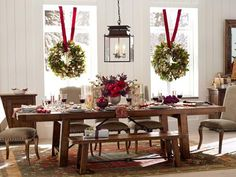 Dining Room Design Gallery | Pottery Barn  I love the wreath hung over the window!