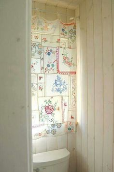 Vintage hankie curtain. Could do this with all those dainty hankies of Mom's.
