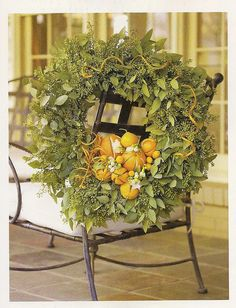 Seeded Eucalyptus Wreath with oranges. To hang on the mirror in Living Room bringing a touch of orange to our christmas decor. Can you imagine the heavenly smell? From the current Southern Accents Christmas magazine.