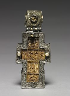 Pectoral Cross. Byzantium, Russia, Byzantine period, 17th century, walrus ivory, wood, partially gilt silver and pearls. The ivory cross is mounted within a silver frame as a pectoral to be worn at the breas, probably by a pries. Cleveland Museum of Art