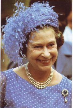 My hats and pins collection is endless?: Queen Elizabeth. .