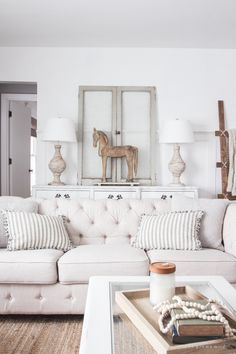 A beautiful farmhouse living room that feels cozy, bright, and totally charming!