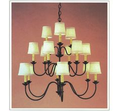"9046  FIFTEEN LIGHT THREE TIER IRON CHANDELIER FINISH SHOWN: PUEBLO SHADE: 3X4X4 WITH ANTIQUE PAPER CANDLES MAXIMUM WATTAGE: 900 CANDELABRA BASE SOCKETS  HT 30"" W 32"""