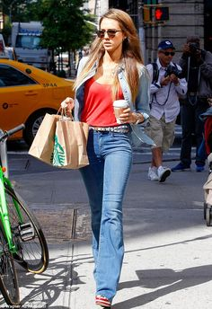 Traffic stopper: The 32-year-old star looked stylish in denim high-waist jeans and orange top as she picked up some drinks to-go at Starbucks