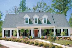 Long for treeline. Tailored for a family. Love the bedroom downstairs, storage in garage. But No wrap around or mudroom. Colonial Style House Plan - 4 Beds 2.5 Baths 2603 Sq/Ft Plan #17-2068 Exterior - Front Elevation - Houseplans.com