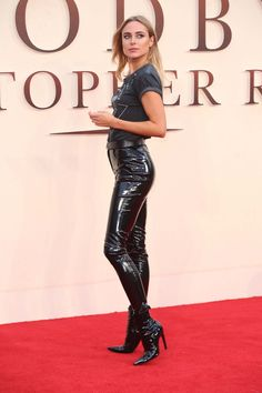 Kimberley Garner at the Goodbye Christopher Robin Premiere in black patent leather pants and ankle boots on red carpet