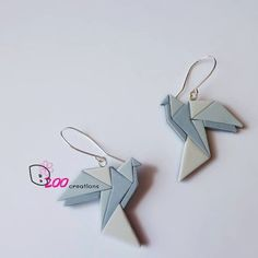 Origami doves earrings. Handmade of polymer clay, based on real origami doves. Sterling silver ear wires.    Size: approx. 4 x 4 cm.  Color: