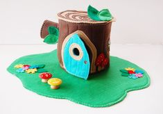 What little one wouldnt love this cute cozy cottage. NOT FOR CHILDREN UNDER AGE 3 OR ANY ONE WHO STILL PUTS THINGS IN THEIR MOUTH> SMALL PARTS CHOKING HAZARD This set comes with. One cottage Tree Stump with lid that flips up and door opens. Also a branch hiding stop. Stands about 8.5 inches