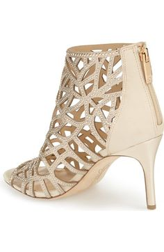 Free shipping and returns on Imagine by Vince Camuto 'Parker' Studded Cage Sandal (Women) at Nordstrom.com. Slender studded straps framing organic-shaped cutouts define the cage of this gorgeous summer sandal. Crafted of luxe satin, it features a flirty open toe and a shimmery wrapped stiletto.