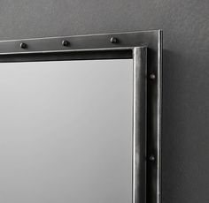 RH's Antiqued Riveted Mirror:The bolts and brackets of factory shelving become chic details on our mirror's metal frame. To create an authentic, work-worn patina, artisans rub and distress the black finish by hand.