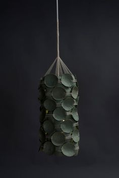 """Designer Kelly Caruso is a recent grad with a degree in Furniture Design and Woodworking but it's her Recycled Pendant Lamps that really caught our attention. What began with a grant from her college to study """"the application of recycled material in furniture design,"""" led her down the path that she's now on and it's a good one."""