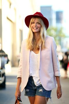 Light pink blazer, jean shorts, white tabd and a red hat
