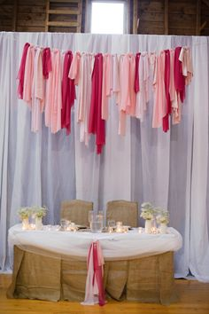 Sweetheart table with fabric strip garland as decor- love! // image by Rachel Peters Photography