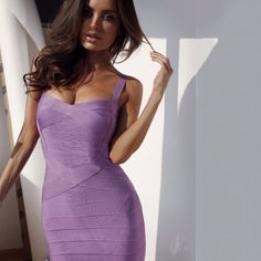 Brunette in a purple bandage dress