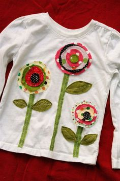 Plain t-shirt transformed into darling top with applique flowers. Would embellish with buttons too.