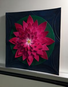 Planes and layers project. I used chip board and acrylic. Each petal is its own separate piece. Base and flower assembled in layers.