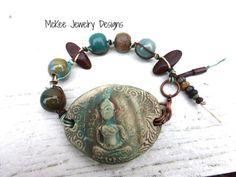 Buddha ceramic cuff, gemstone, copper metal and glass bracelet. Blue and cream jewelry.