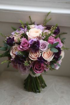 Wedding bouquet of sweet avalanche, ocean song and cool water roses, waxflower eustoma and sweet peas. Liberty blooms (Mix Wedding)