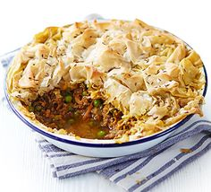 Cover spiced lamb mince, stewed potato and peas with crispy filo pastry for a low-fat, Indian-inspired dinner