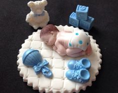Fondant baby girl on a pink blanket cake by evynisscaketopper