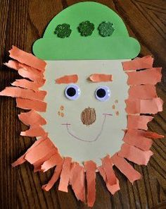 Kids' St. Patrick's Day crafts like this Lucky the Leprechaun craft are easy decorative crafts for small children. Make the funny and festive face of a mischievous leprechaun into paper crafts for kids!