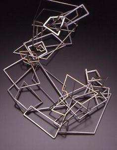 geometric links. -- Seth PAPAC neckpiece silver & gold