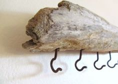 Driftwood and Hooks...Clever alternative for a coat rack!