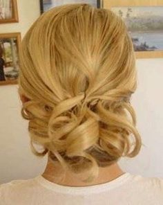 Found this up-do that is apparently for short hair, looks kinda beachy, I like it because its loose and simple! I think flowers would look good in it too