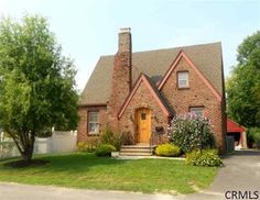 brick tudor house | small tudor-style home. love the brick, but it needs some ivy growing ...