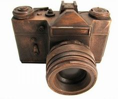This camera sculpture is made out of chocolate. It looks like an exact replica of a vintage camera from the lens and the form. I like how the piece looks kind of rusty and old.
