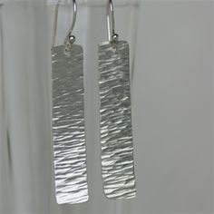 River Earrings in sterling silver hammered texture makes these simple earrings appear to move like water in a river.