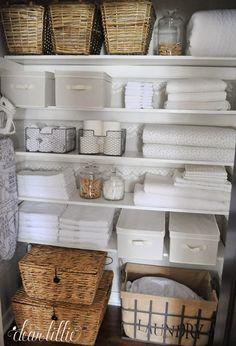 linen closet storage options (wicker baskets, canvas bins, wire baskets, glass jars)