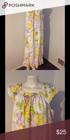 "Vintage Floral Long Ruffle Nightgown Very nice vintage long nightgown. Purple, yellow and white floral with a ruffle around the bottom. Fabric seems to be a poly/cotton been and is not stretchy. Will fit M/L. Great condition. Chest 47"" Length 50"" Vintage Intimates & Sleepwear"