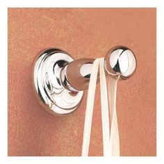 Ginger Satin Nickel Sussex Single Hook by Ginger. $19.88. Image shown may not be finish indicated. Available in Brass, Chrome, Chrome/Brass, Polished Nickel and Satin Nickel. Ginger Sussex single hook.  A petite rosette that measures 2.1 inches in diameter.  With subtle detailing this item is 2.1 inches wide, 2.1 inches high and protrudes 2.8 inches from the wall.. Save 57%!