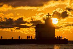 Fisherman By the Lighthouse - photo by Bill Pevlor of PopsDigital.com. #lighthouse #sunrise #kewaunee #lakemichigan #silhouette