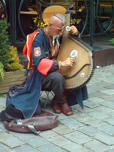 Street musician ~ Ostap Kindraczuk ~ playing the bandura, a Ukrainian zither on Old Market in Poznań (Poland)