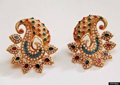 Paisely shaped stone pearl  studded ear top.