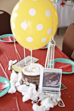 Welcome To The World Baby Shower! Love this Hot Air Balloon diaper centerpiece!