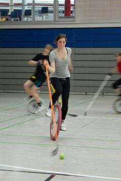 Hockey on monocycles!