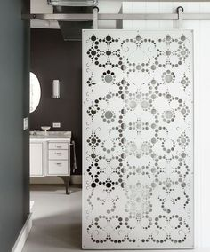 Interior textured barn doors have a variety of surface embellishments that vary with their materials, age and style. via Atticmag
