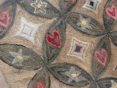 """Hooked rug at """"just folk"""", via Flickr."""