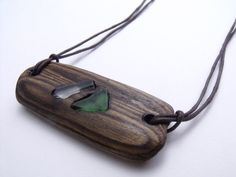 The length around the neck approx. 56cm.    This piece is made from driftwood that I find on my local beach. I sand and varnish the wood. Varnishing ensured that the wood is water and scratch resistant. It also highlights the natural beauty of the wood grain. I have burned into the wood and inserted sections of glass from the shore. At the back, I have used a copper lobster clasp and hoop to secure around the neck. I have also wrapped the ends of thong is copper wire to match the copper…