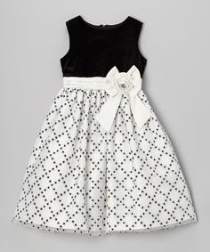 Look at this Jayne Copeland Black & White Glitter Diamond Dress - Girls on today!This frock is all dressed up and has everywhere to go. Coming in an easy-to-move-in silhouette with a full skirt, it can get on and to the dance floor in no time. Kids Party Wear Dresses, Kids Dress Wear, Little Girl Outfits, Little Girl Dresses, Kids Outfits, Girls Dresses, Baby Frocks Designs, Kids Frocks Design, Baby Girl Dress Patterns