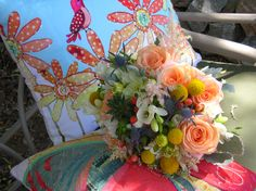 Coral roses, pink astible, freesia, crapsida, thistle, dahlia, succulent bouquet~Stems Flower Shop