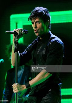 Enrique Iglesias performs on FOX's 'The X Factor' Season 3 Top 4 To 3 Live Elimination Show on December 12, 2013 in Hollywood, California.