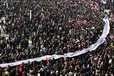 Pro-government supporters hold up a letter directed to President Bashar Assad at a gathering at Saadallah al-Jabiri Square in Aleppo, Syria