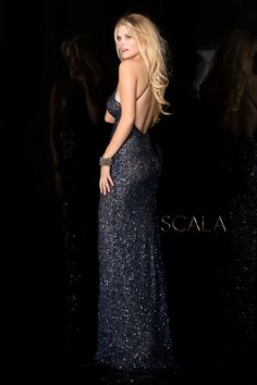8bc1298e1a Scala 47542 stunning fitted gown with a v-neckline and an open back with  adjustable criss cross straps.