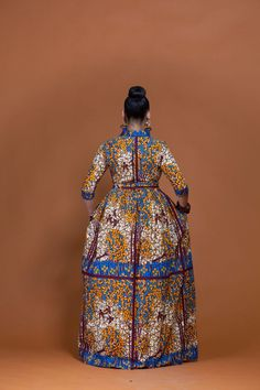 A stunning example of handmade African fashion, the Togo maxi dress is bold, beautiful and perfect for showing off your curves. Latest African Fashion Dresses, African Dresses For Women, African Wear, African Inspired Fashion, African Print Fashion, Fashion Prints, Ankara Short Gown Styles, Dress Styles, Feminine Style